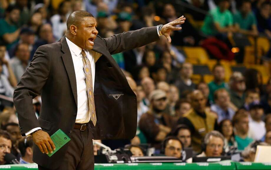 Celtics coach Doc Rivers  makes calls to his team against the San Antonio Spurs on Nov. 21, 2012 at TD Garden in Boston. (Jared Wickerham / Getty Images)