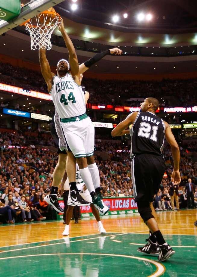 Chris Wilcox #44 of the Boston Celtics dunks in front of Tim Duncan #21 of the San Antonio Spurs on Nov. 21, 2012 at TD Garden in Boston. (Jared Wickerham / Getty Images)