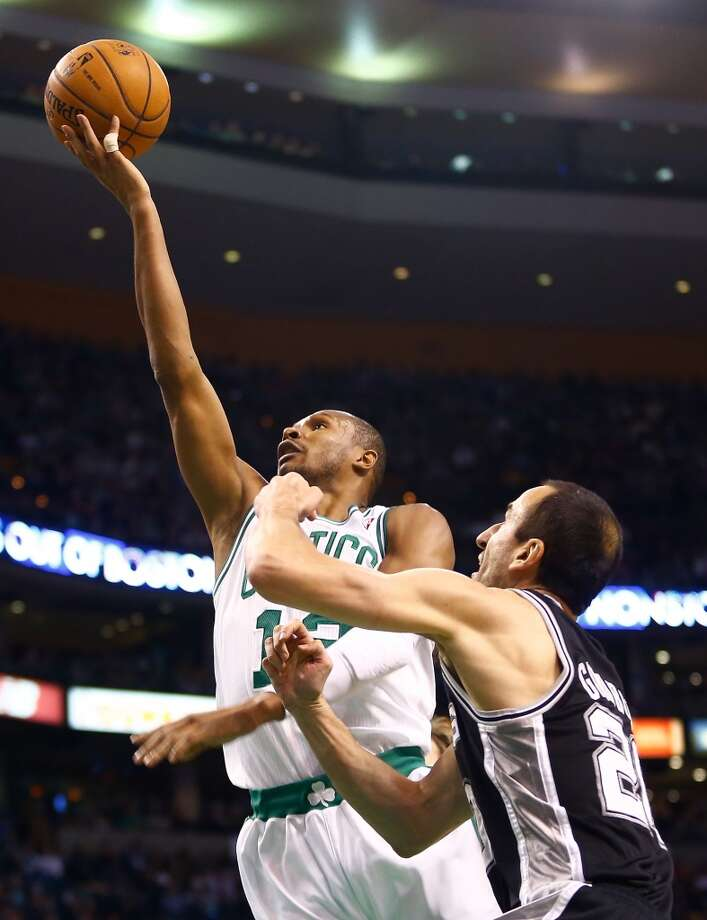 Leandro Barbosa #12 of the Boston Celtics drives to the basket for a layup in front of Manu Ginobili #20 of the San Antonio Spurs on Nov. 21, 2012 at TD Garden in Boston. (Jared Wickerham / Getty Images)