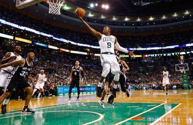 Rajon Rondo #9 of the Boston Celtics drives to the basket for a layup against the San Antonio Spurs on Nov. 21, 2012 at TD Garden in Boston. (Jared Wickerham / Getty Images)