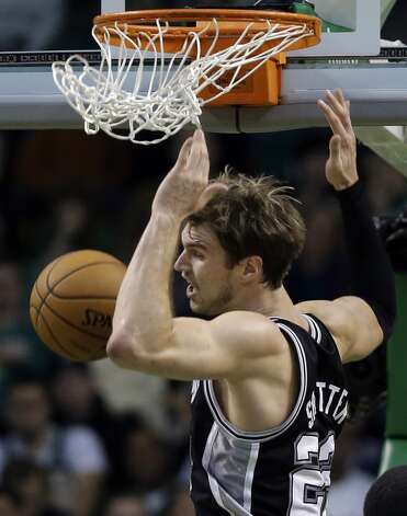 San Antonio Spurs power forward Tiago Splitter (22) dunks against the Boston Celtics during the second half of an NBA basketball game in Boston, Wednesday, Nov. 21, 2012. The Spurs won 112-100. (Elise Amendola / Associated Press)