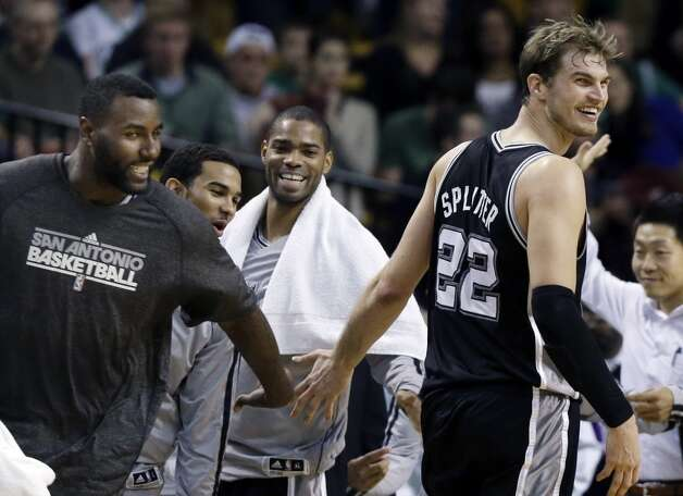San Antonio Spurs power forward Tiago Splitter (22) receives congratulation from center DeJuan Blair, far left, and others on the bench late in the fourth quarter of an NBA basketball game against the Boston Celtics in Boston, Wednesday, Nov. 21, 2012. The Spurs won 112-(AP Photo/Elise Amendola) (Elise Amendola / Associated Press)