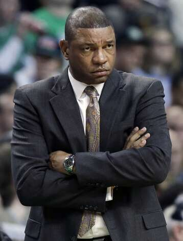 Boston Celtics head coach Doc Rivers reacts during the fourth quarter of an NBA basketball game against the San Antonio Spurs in Boston, Wednesday, Nov. 21, 2012. The Spurs won 112-100.  (Elise Amendola / Associated Press)