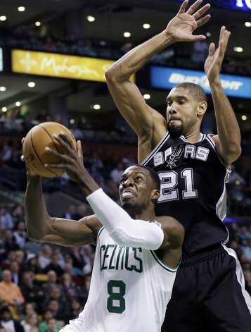 San Antonio Spurs power forward Tim Duncan (21) defends against Boston Celtics forward Jeff Green (8) during the second half of an NBA basketball game in Boston, Wednesday, Nov. 21, 2012. The Spurs won 112-100. (Elise Amendola / Associated Press)