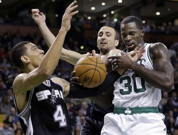 San Antonio Spurs guards Danny Green (4) and Manu Ginobili, center, fight for a loose ball with Boston Celtics forward Brandon Bass (30) during the second half of an NBA basketball game in Boston, Wednesday, Nov. 21, 2012. The Spurs won 112-100. (Elise Amendola / Associated Press)