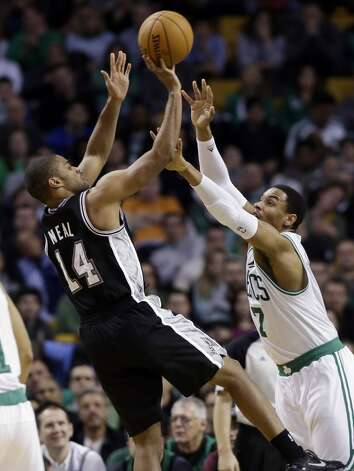 San Antonio Spurs point guard Gary Neal (14) shoots over Boston Celtics forward Jared Sullinger (7) during the second half of an NBA basketball game in Boston, Wednesday, Nov. 21, 2012. The Spurs won 112-100.  (Elise Amendola / Associated Press)