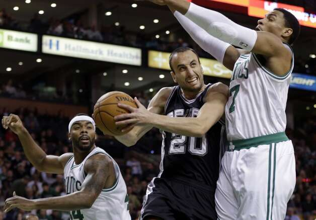 San Antonio Spurs shooting guard Manu Ginobili (20) drives to the hoop against Boston Celtics forward Chris Wilcox, left, and forward Jared Sullinger (7) during the first half of an NBA basketball game in Boston, Wednesday, Nov. 21, 2012.  (Elise Amendola / Associated Press)