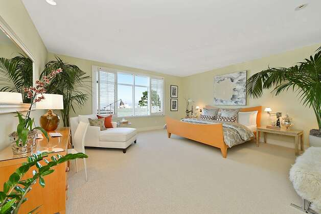 Large and carpeted, the master suite includes matching walk-in closets, built-in organizational units, and plantation shutters over the windows that provide a glimpse of Mount Diablo and Point Reyes. Photo: OpenHomesPhotography.com