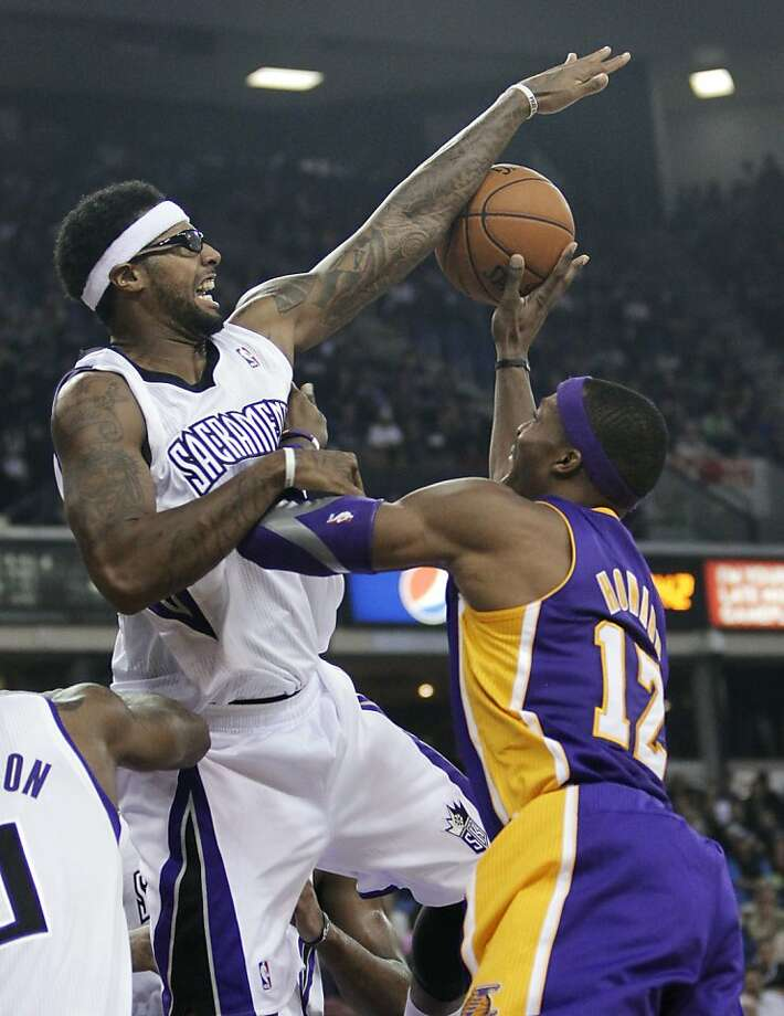 The Kings' James Johnson blocks a shot by the Lakers' Dwight Howard. Photo: Rich Pedroncelli, Associated Press
