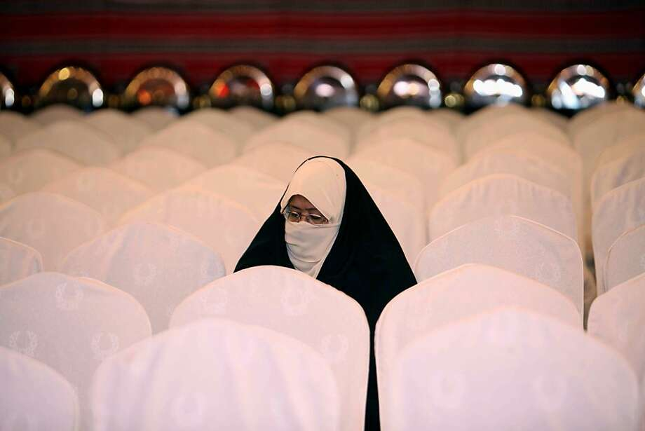 At a campaign rally in Kuwait City, a Shiite Muslim woman lends her support to Mona al-Ghareeb, a candidate in upcoming parliamentary elections in the Gulf emirate. Photo: Yasser Al-Zayyat, AFP/Getty Images