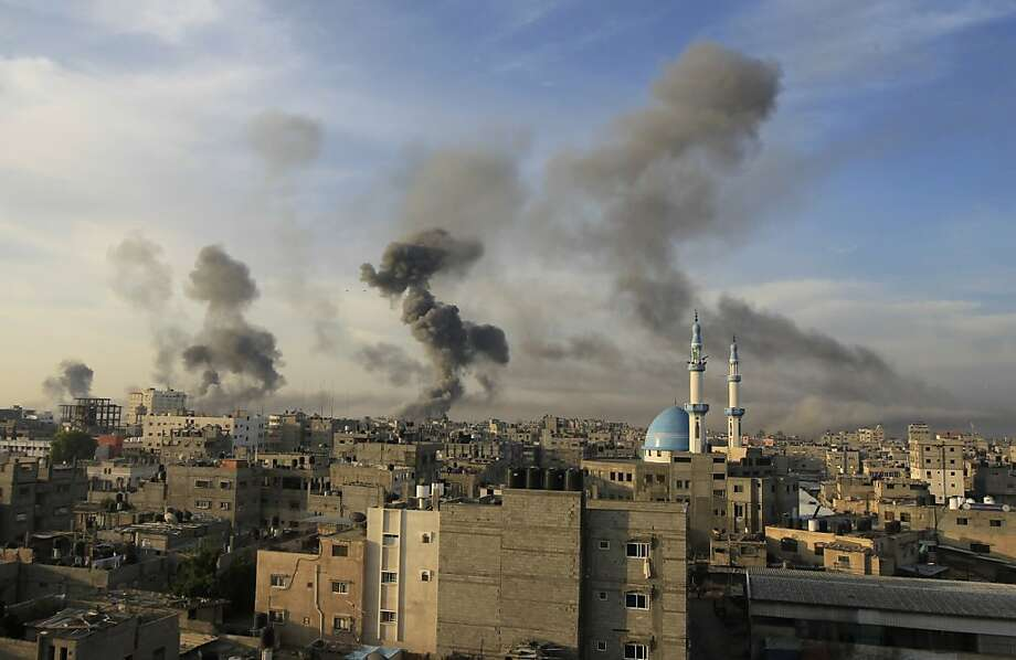 Smoke billows after Israeli air strikes near smuggling tunnels between the southern Gaza Strip and Egypt, on November 21, 2012 in Rafah. Fighting raged on both sides of Gaza's borders Wednesday despite intensified efforts across the region to thrash out a truce to end a week of violence that has cost 136 Palestinian and five Israeli lives. Photo: Said Khatib, AFP/Getty Images