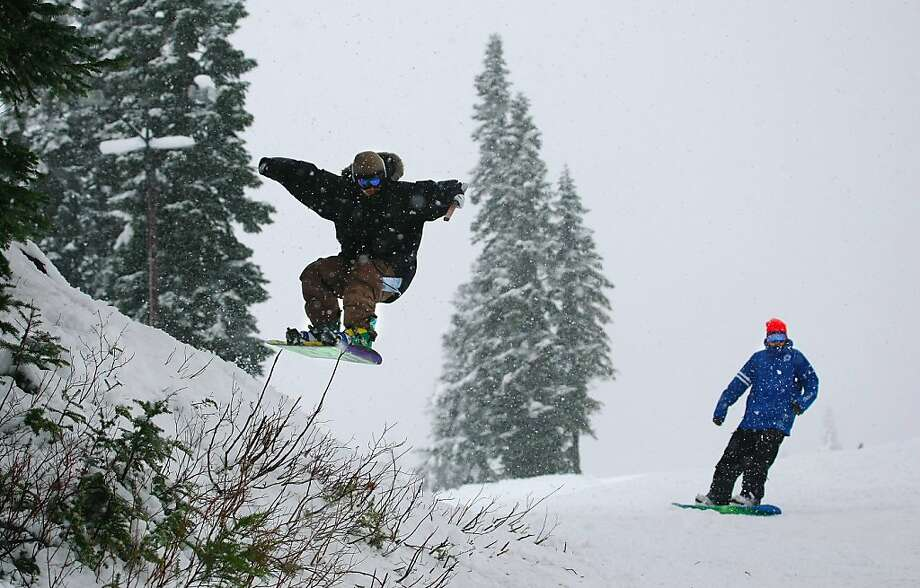 In this photo taken Tuesday afternoon, Nov. 20, 2012, A snowboarder catches air on his way down the mountain at Stevens Pass, Wash., ski area. Two lifts opened at Stevens Pass ski area Tuesday at noon, making Stevens Pass the first ski mountain in Washington State to open this season. Photo: Mark Mulligan, Associated Press