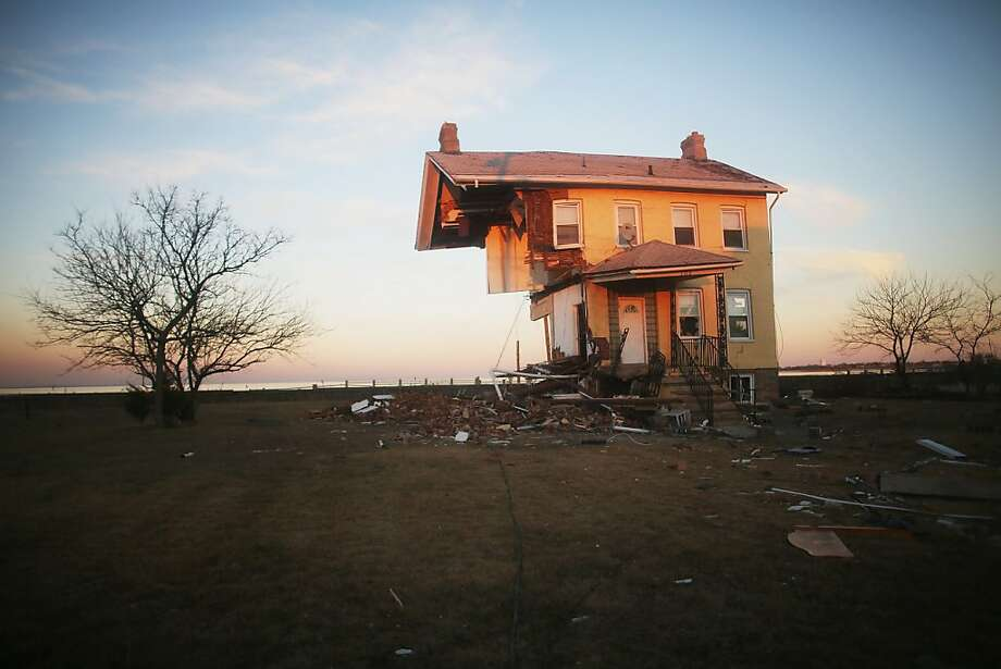 The iconic Princess Cottage, built in 1855, remains standing after being ravaged by flooding on November 21, 2012 in Union Beach, New Jersey. Little more than half of the home remains and more than 200 homes were destroyed by Superstorm Sandy in the town. Photo: Mario Tama, Getty Images