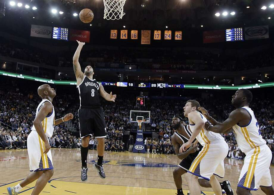 Brooklyn Nets' Deron Williams (8) scores against the Golden State Warriors during the first half of an NBA basketball game in Oakland, Calif., Wednesday, Nov. 21, 2012. (AP Photo/Marcio Jose Sanchez) Photo: Marcio Jose Sanchez, Associated Press