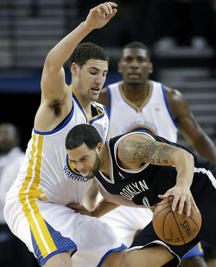 Golden State Warriors' Klay Thompson, left, defends Brooklyn Nets' Deron Williams during the second half of an NBA basketball game in Oakland, Calif., Wednesday, Nov. 21, 2012. Golden State won 102-93. (AP Photo/Marcio Jose Sanchez) Photo: Marcio Jose Sanchez, Associated Press