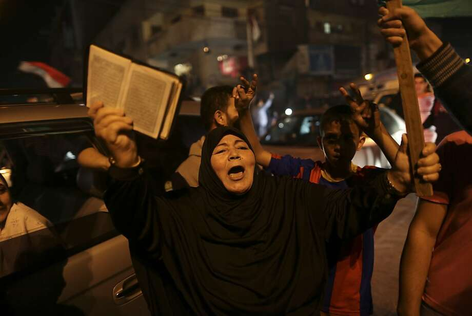 Palestinians celebrate in Gaza City after Israel and Hamas agreed to a cease-fire, ending days of fighting that killed 166 people. The deal was brokered by Egypt, which will take the lead in keeping the peace. Photo: Wissam Nassar, New York Times