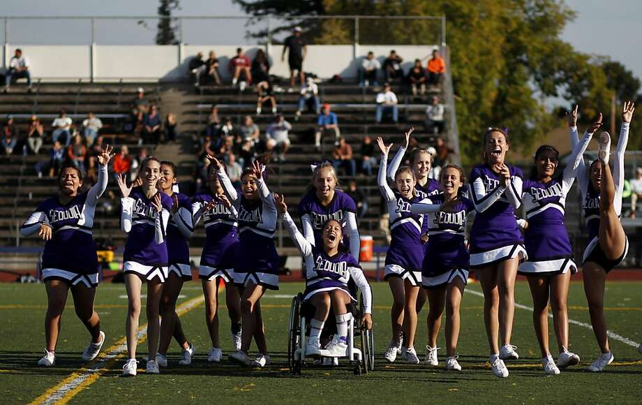 Sequoia High School junior varsity cheerleader Angel Gonzalez-Prado (in wheelchair) cheers with her teammates during the junior varsity football game on Friday, September 28, 2012 in Redwood, Calif. Photo: Beck Diefenbach, Special To The Chronicle