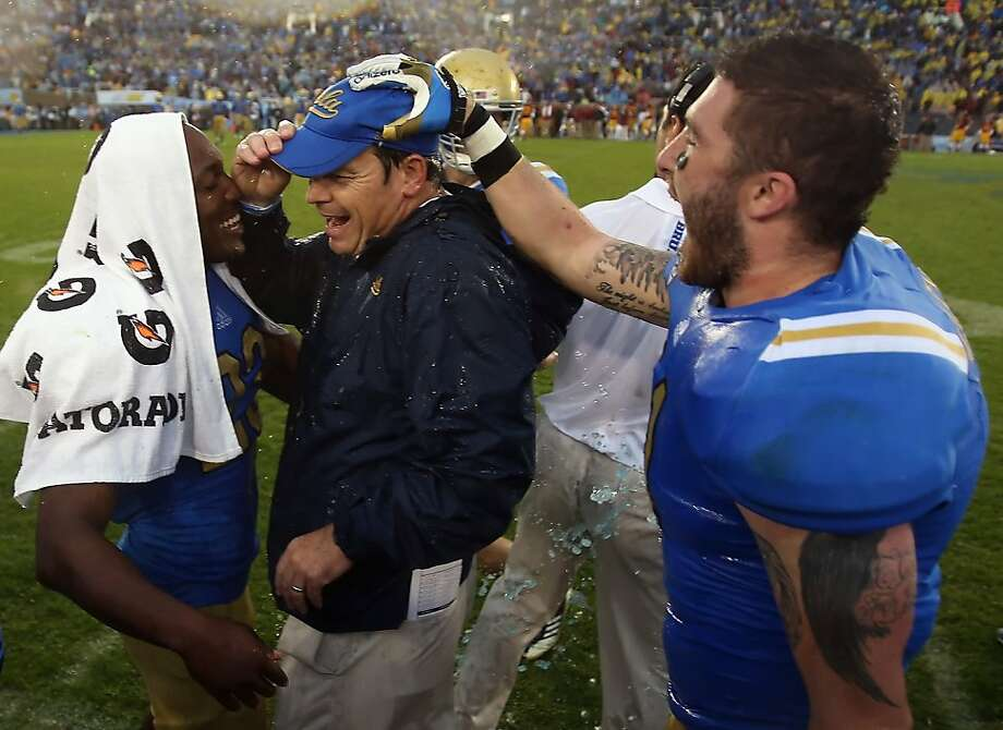 Jim Mora (center), who spent 25 years coaching in the NFL, has turned UCLA's program into a winner in his first season. Photo: Jeff Gross, Getty Images