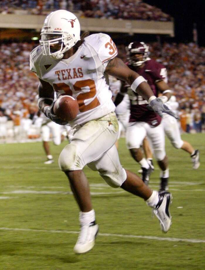 2003Texas 46, Texas A&M 15Cedric Benson rushed for 283 yards and four touchdowns as the Longhorns rolled over their rivals in College Station. (Erich Schlegel / Dallas Morning News)