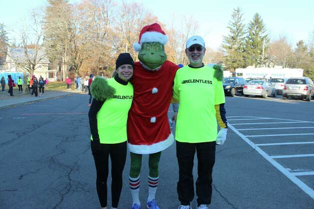 Even the Grinch was smiling, sort of, at Thursday's Turkey Trot