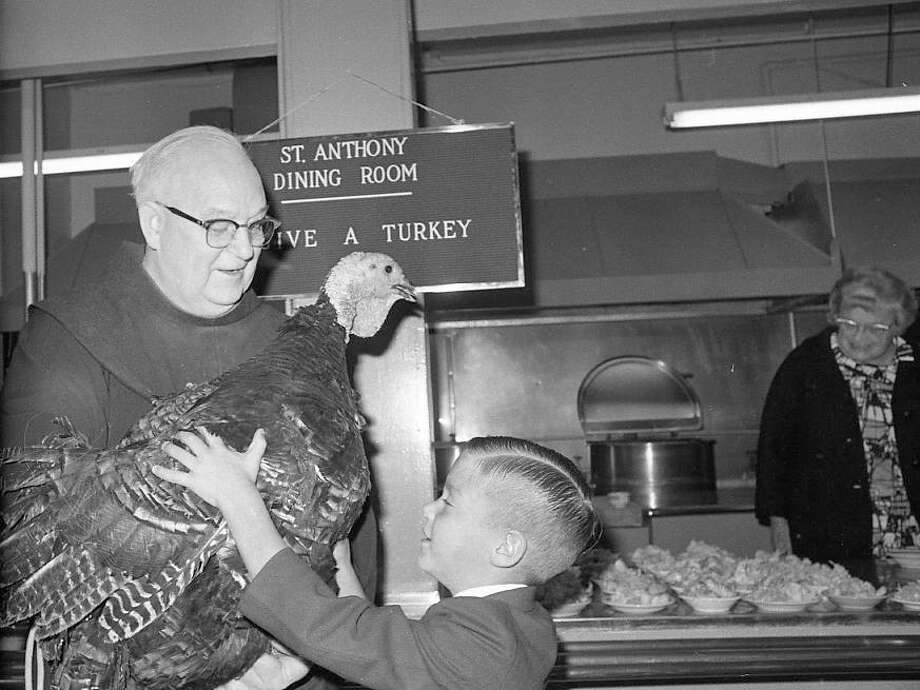November 11, 1969: For anyone who thinks St. Anthony's Dining Room is a depressing place, I present to you the turkey high jinks of Father Alfred Boeddeker. He had two turkeys -- the second was curiously absent from the later photos. I'm guessing this kid, now in his 50s, is a vegan ...