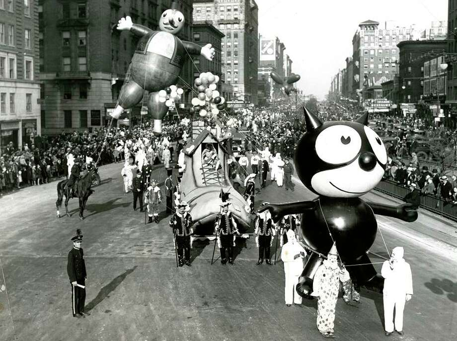 Nov. 24, 1932: Felix the Cat looks a little stoned in just the sixth Macy's Thanksgiving Day parade. He's tethered to three very creepy looking clowns. Even though it's the 1930s, I still half-expect to see a Bart Simpson float in the background. (ONLINE_YES) Photo: Associated Press / ONLINE_YES