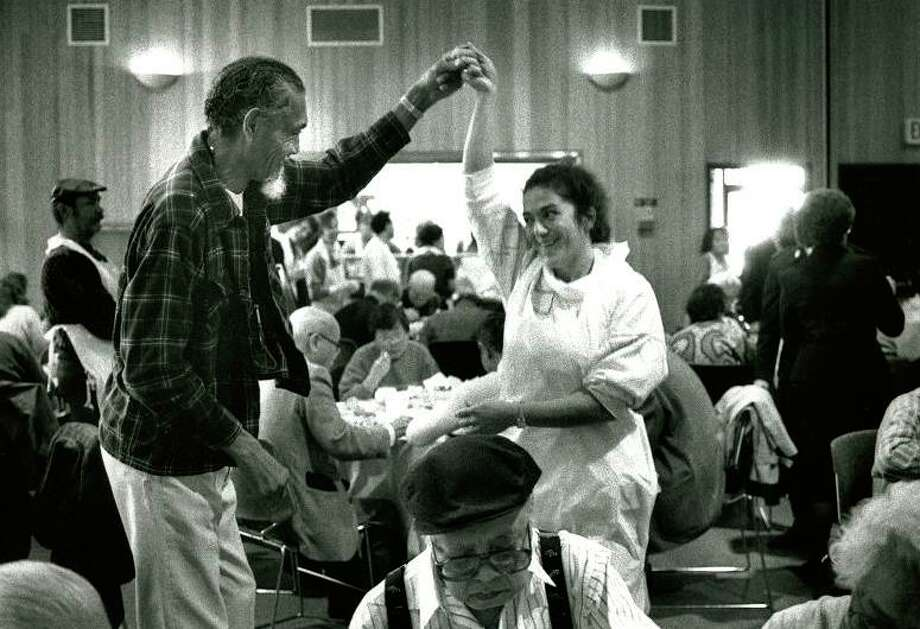 "Nov. 22, 1990: At the Salvation Army senior center in SF, resident Edmond ""Happy"" Howard dances with volunteer nurse Nevart Dertorossian. This photo makes me feel good about mankind. Happy Thanksgiving, everyone! Photo: Deanne Fitzmaurice, The Chronicle / ONLINE_YES"