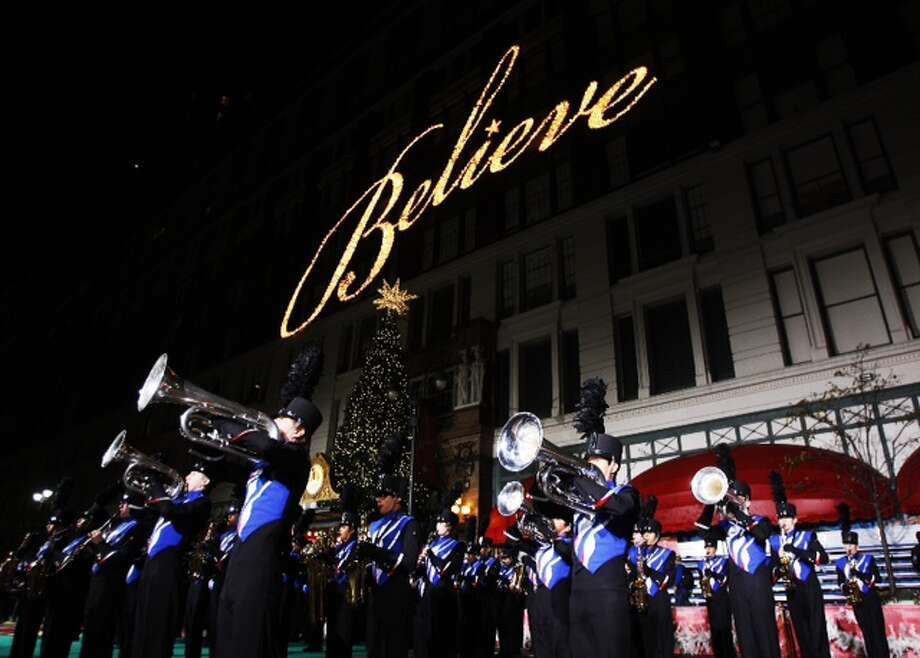 The Oak Ridge High School Marching Band rehearses in front of the Macy's store as they prepare to march in the Macy's Thanksgiving Day Parade this morning in New York. (Brett Coomer / Houston Chronicle) Photo: .
