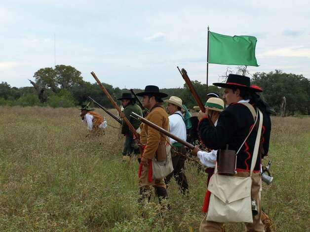 A group of re-enactors march toward their Spanish enemy during the Filming Bill MilletÕs coming documentary Texas Before the Alamo, which will feature the Battle of Medina. Photo: Mark D. Wilson/ Southside Report