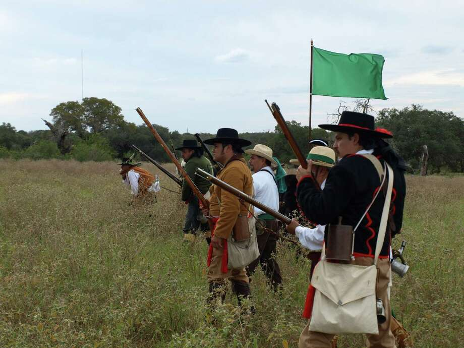 "A group of re-enactors march toward their Spanish enemy during the Filming Bill Millet's coming documentary ""Texas Before the Alamo,"" which will feature the Battle of Medina. Photo: Mark D. Wilson, Southside Reporter / Primetime Newspapers"
