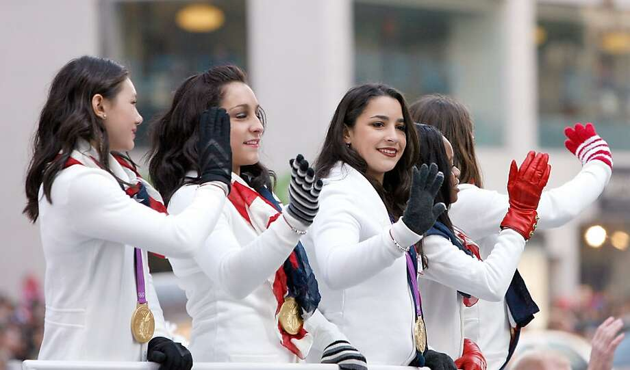 (Left to right): U.S. Olympic gymnasts Kyla Ross, Jordyn Wieber, Alexandra Raisman, Gabby Douglas and McKayla Maroney attend the 86th Annual Macy's Thanksgiving Day Parade. Photo: Mike Lawrie, Getty Images