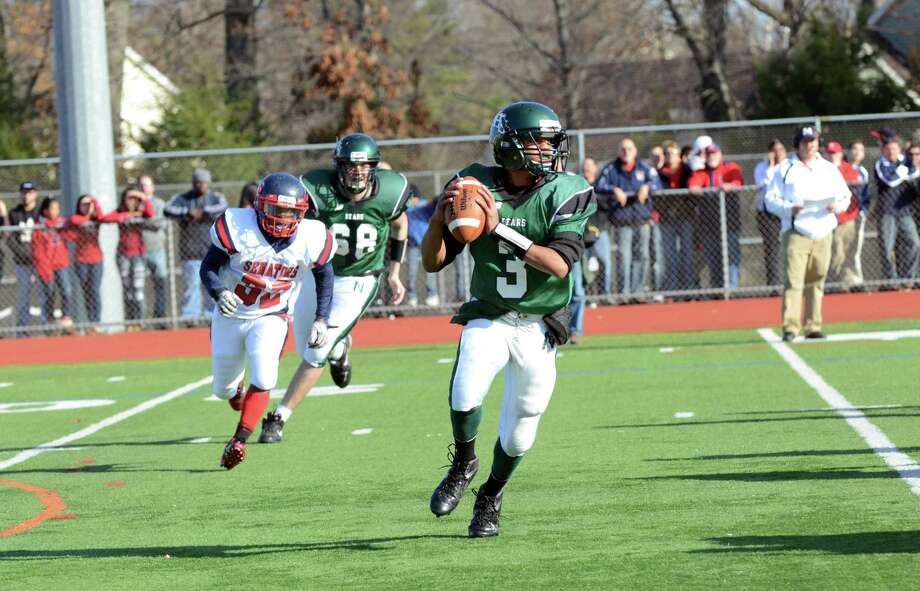 Norwalk's Jeremy Linton (3) looks to pass as Norwalk hosts Brien McMahon High School during the Thanksgiving Day football game on Thursday, Nov. 22, 2012. Photo: Amy Mortensen / Connecticut Post Freelance