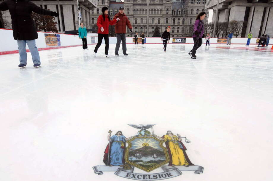 Skaters enjoy the first day of the re-opening of the Empire State Plaza ice rink at the Capitol in Albany on Dec.31, 2011. (Times Union archive)