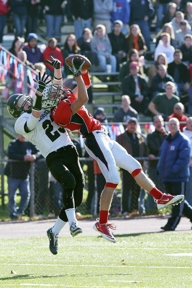 Mike Ross Connecticut Post freelance -Foran High School's # 23 Connor Cadrin battles and intercepts the pass from Jonathan Law's #23 Timmy Speer during first action on Thanksgiving football match-up. Photo: Mike Ross / Connecticut Post Freelance
