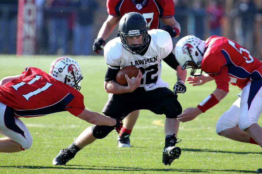 Mike Ross Connecticut Post freelance - Jonathan Law's #22 Timmy Maher gains yardage against Foran High School during first action on Thanksgiving football match-up on Thursday morning. Photo: Mike Ross / Connecticut Post Freelance
