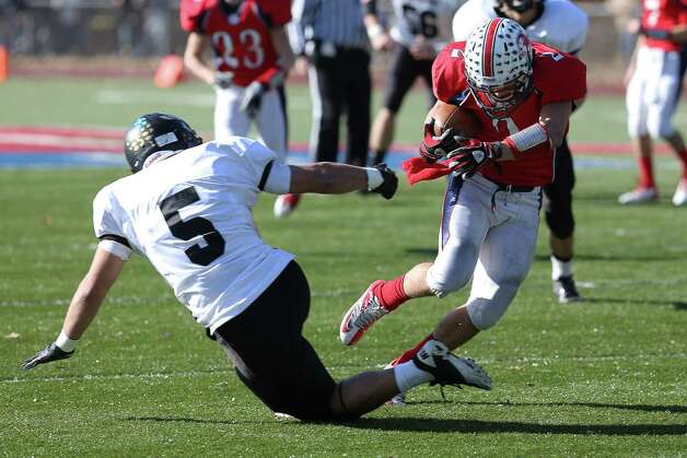 Mike Ross Connecticut Post freelance - Foran High School's # 2 Nicholas Weissauer escapes the tackle from Law's # 5 (name not on roster) during first half action on Thamksgiving day. Photo: Mike Ross / Connecticut Post Freelance