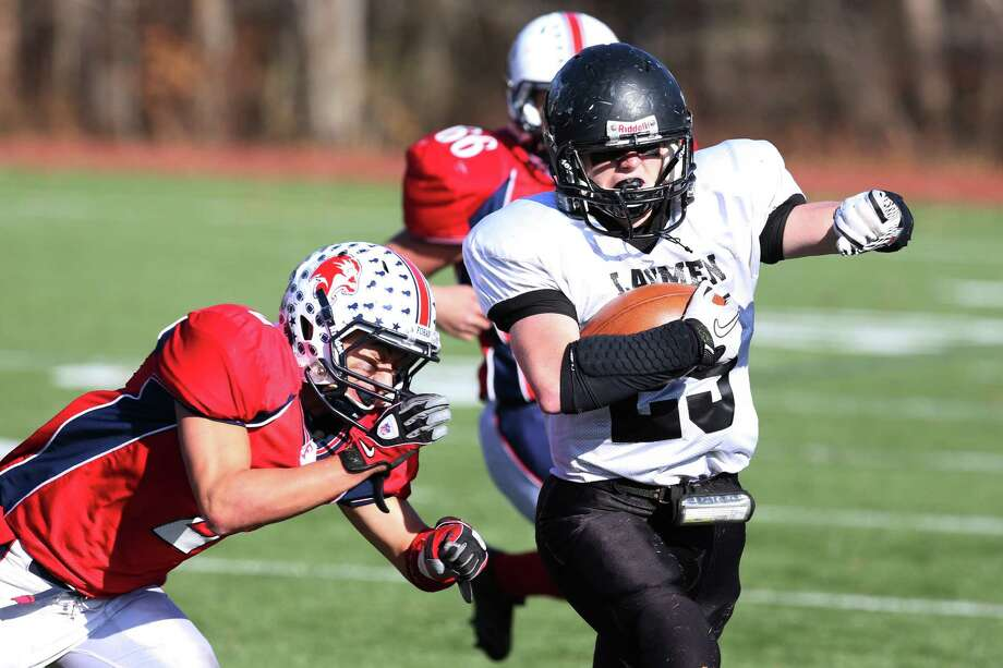 Mike Ross Connecticut Post freelance - Jonathan Law's #25  Danny Ziebell gains a first down during  Thanksgiving football match-up against Foran High School. Photo: Mike Ross / Connecticut Post Freelance