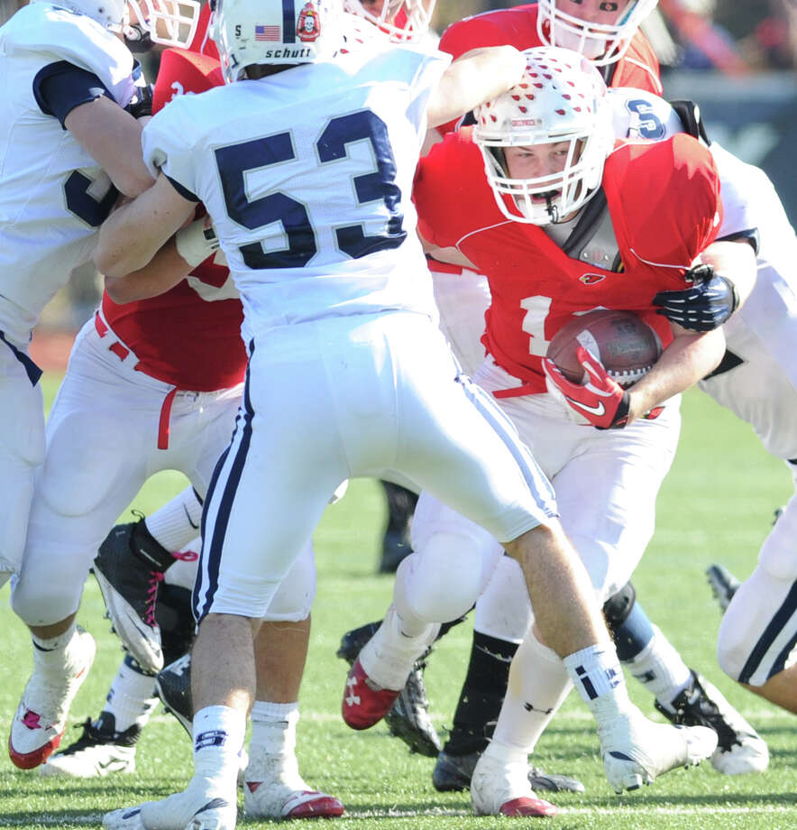 Greenwich running back Alex McMurray, right, # 11, has trouble finding a hole just before being tackled by Brian Book # 53 of Staples duriing the 4th quarter of the FCIAC championship football game between Staples High School and Greenwich High School at Greenwich, Thursday afternoon, Nov. 22, 2012. Staples defeated Greenwich 48-30 to win the championship. Photo: Bob Luckey / Greenwich Time
