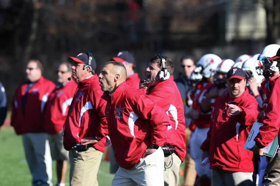 Mike Ross Connecticut Post freelance -Foran High School coaches work the sidelines during Thanksgiving day match-up against Jonathan Law High School on Thursday morning. Photo: Mike Ross / Connecticut Post Freelance