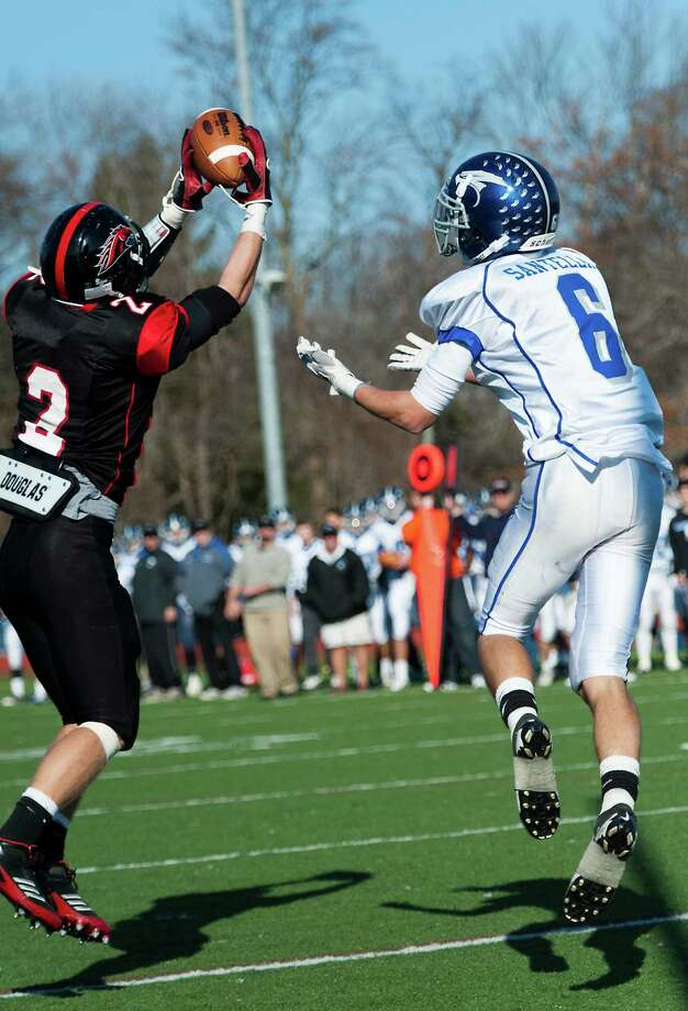 Fairfield Warde high school's Ryan Jacob makes an interception on a pass intended for Fairfield Ludlowe high school's Daniel Santella in the annual Thanksgiving Day football game played this year at Fairfield Warde high school, Fairfield, CT Thursday November 22nd, 2012. Photo: Mark Conrad / Connecticut Post Freelance
