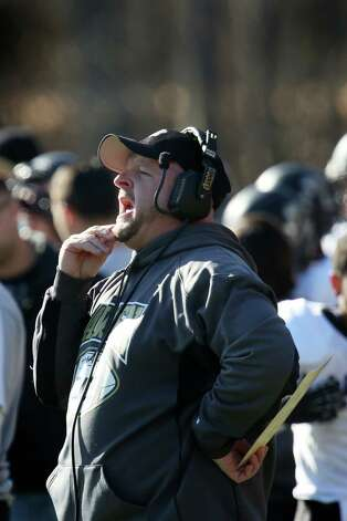 Mike Ross Connecticut Post freelance - Jonathan law football coach Mark Robinson works the sidelines during Thursday morning Thanksgiving Day match-up against Foran High School. Photo: Mike Ross / Connecticut Post Freelance