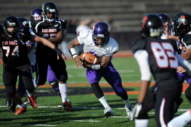 Westhill's Davell Cotterell carries the ball during a football game at Stamford High School on Thanksgiving day, Thursday, November 22, 2012. Photo: Lindsay Niegelberg / Stamford Advocate