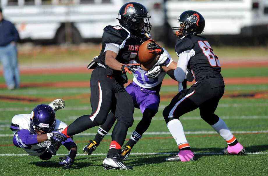 Stamford's Cameron Webb avoids being tackled as he runs for a touchdown during Thursday's game at Stamford High School on Thanksgiving day, November 22, 2012. Photo: Lindsay Niegelberg / Stamford Advocate