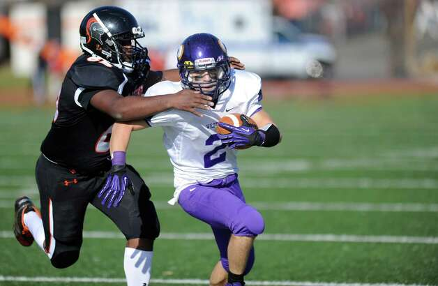 Westhill's Tim Longo is tackled by Stamford's David Gillette during Thursday's game at Stamford High School on Thanksgiving day, November 22, 2012. Photo: Lindsay Niegelberg / Stamford Advocate