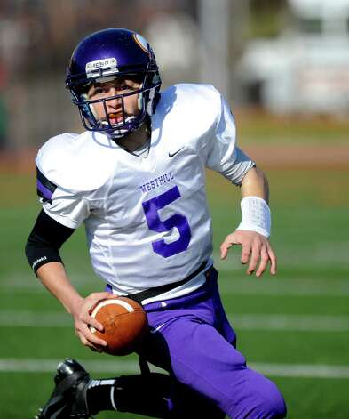 Westhill's Ryan Coppolla carries the ball during Thursday's game at Stamford High School on Thanksgiving day, November 22, 2012. Photo: Lindsay Niegelberg / Stamford Advocate