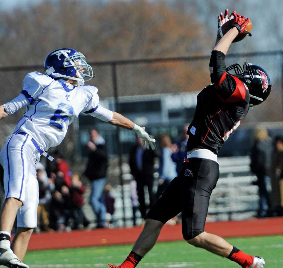 Fairfield Warde high school's Mark Byrne makes a catch in the annual Thanksgiving Day football game against Fairfield Ludlowe high school played this year at Fairfield Warde high school, Fairfield, CT Thursday November 22nd, 2012. Photo: Mark Conrad / Connecticut Post Freelance