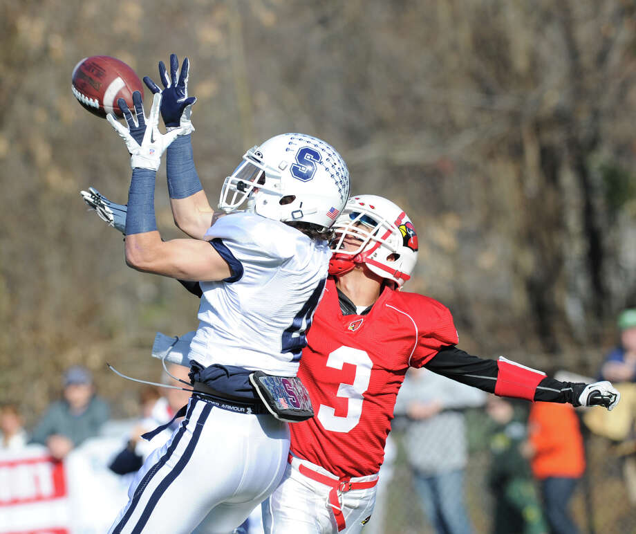 Staples receiver James Frusciante, left, # 4, catches the first touchdown of the game as Austin Longi # 3 of Greenwich fails to break-up the pass during the first quarter of the FCIAC championship football game between Staples High School and Greenwich High School at Greenwich, Thursday afternoon, Nov. 22, 2012. Staples defeated Greenwich 48-30 to win the championship. Photo: Bob Luckey / Greenwich Time