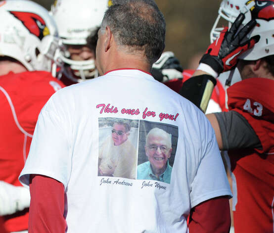 "Greenwich football coach Rich Albonizio wears a ""This Ones for You!"" T-shirt during the FCIAC championship football game between Staples High School and Greenwich High School at Greenwich, Thursday afternoon, Nov. 22, 2012. The shirt pictures John Andrews and John Wynne, both men recently passed away and had close ties and were supporters of the Greenwich High School football program. Staples defeated Greenwich 48-30 to win the championship. Photo: Bob Luckey / Greenwich Time"