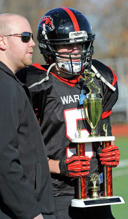 Fairfield Warde high school's Mark Byrne holding the MVP trophy awarded to the most valuable player of the Warde football team in the annual Thanksgiving Day football game against Fairfield Ludlowe high school played this year at Fairfield Warde high school, Fairfield, CT Thursday November 22nd, 2012. Photo: Mark Conrad / Connecticut Post Freelance