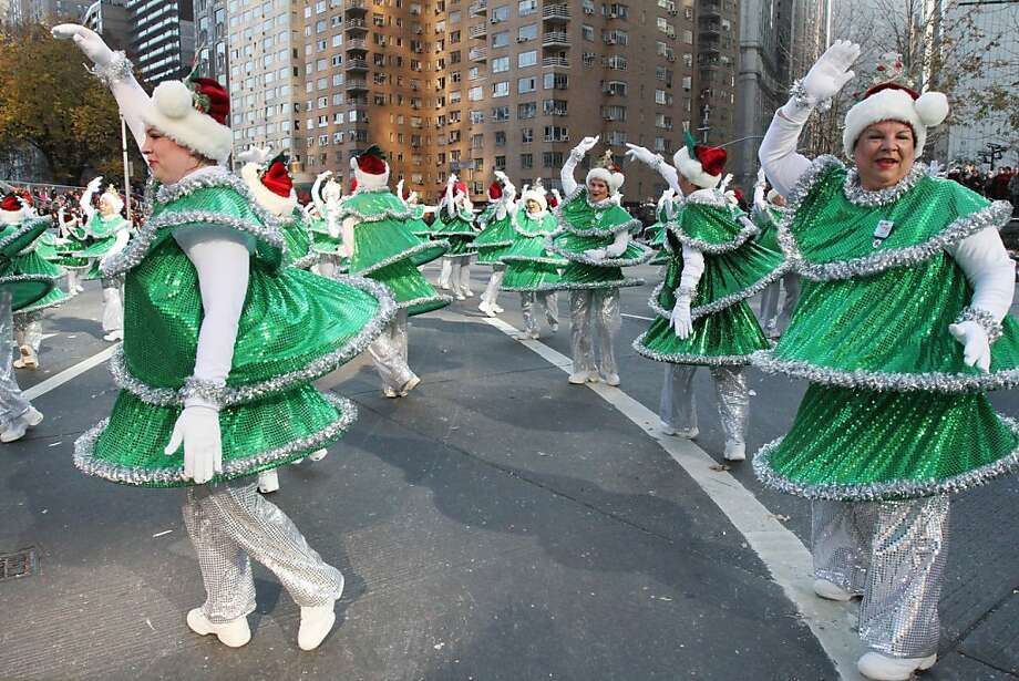 The Tap Dancing Christmas Trees make their way through New York's Columbus Circle during the 86th Annual Macy's Thanksgiving Day Parade, Thursday Nov. 22, 2012, in New York. Photo: Tina Fineberg, Associated Press